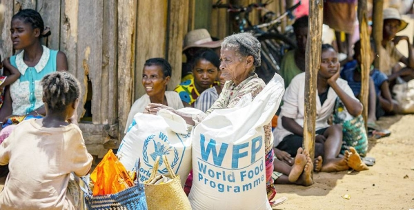 Residents in the drought affected communities of Ifotaka, southern Madagascar, collect food assistance provided by the UN World Food Progamme. — courtesy WFP/Tsiory Andriantsoarana