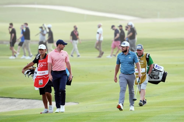 Rory McIlroy of Northern Ireland and Tyrrell Hatton of England walk on the 18th hole during Day Three of the Abu Dhabi HSBC Championship at Abu Dhabi Golf Club on Saturday in Abu Dhabi, United Arab Emirates. (Photo by Ross Kinnaird)