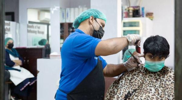 Facemasks are worn at a hair salon in Karachi, Pakistan. — courtesy IMF/Saiyna Bashir