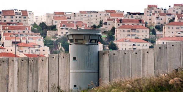 The Separation Wall in the occupied Palestinian Territory and behind it an Israeli settlements. — courtesy Photo/Ryan Rodrick Beiler
