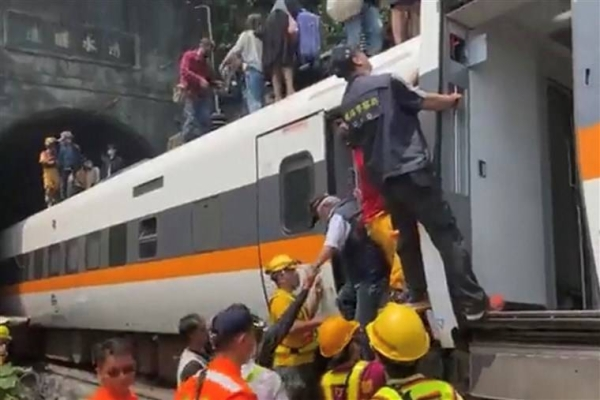 A busy passenger train carrying 490 people has derailed in a tunnel in eastern Taiwan, killing at least 51 and injuring dozens more. — Courtesy photo