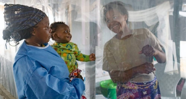 File photo shows a plastic sheet separating a mother from her son at an Ebola treatment center in Beni, North Kivu province, Democratic Republic of the Congo. — courtesy UNICEF/Thomas Nybo