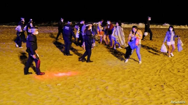 Law enforcement officers in Barcelona were called in to disperse people drinking and dancing in the city center and on a nearby beach in the first weekend since Spain lifted its state of emergency. — Courtesy photo