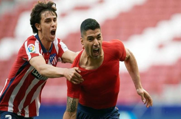 Luis Suarez earned rivals Atletico Madrid the first La Liga in seven years after holding off the title challenge of city rivals Real by coming from behind to beat Real Valladolid 2-1.