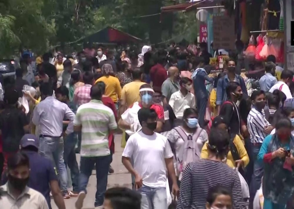 People throng markets in Sarojini Nagar in the national capital after lockdown restrictions were eased.