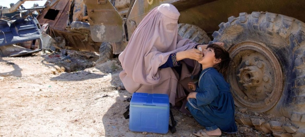 A UN-supported polio worker in Afghanistan administers a polio vaccine to a young child. — Courtesy file photo