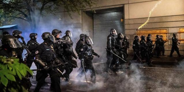 About 50 officers assigned to the Portland police department's crowd control team resigned one day after one of the team's officers was indicted for allegedly using his department-issued baton to assault a protester last summer. — Courtesy file photo