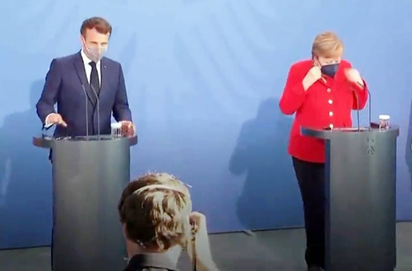 A videograb of German Chancellor Angela Merkel and French President Emmanuel Macron addressing a press conference in Berlin.