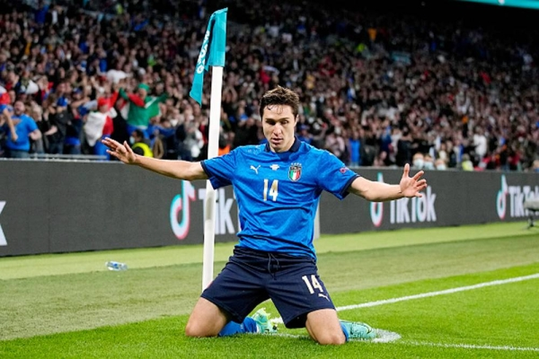 Italy's Federico Chiesa celebrates his side's first goal after he curled a beautiful strike into the far corner of Unai Simon's net.