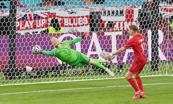 Denmark goalkeeper Kasper Schmeichel saves a super close range shot from England's Mount to keep the Danes in the hunt for Euro 2020 final spot at Wembley on Wednesday. His heroics however, could not stop England from advancing.