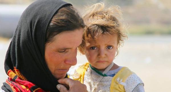 Yazidis who fled Sinjar Mountain re-enter Iraq from the Syrian Arab Republic. (file). — courtesy UNICEF/Khuzaie