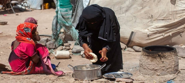 A seven-year-old girl watches as her mother make bread in Mokha, Yemen. — Courtesy file photo