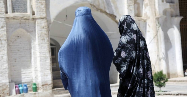 Two Afghan women walk near an ancient mosque in western Herat province. — courtesy UNAMA