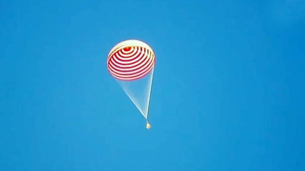 The three taikonauts from China's Shenzhou-12 manned spaceflight mission made their first appearance out of the re-entry capsule after safely landing back on Earth local time on Friday afternoon.