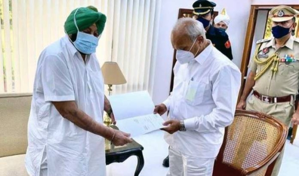 Punjab Chief Minister Captain Amarinder Singh submits his resignation letter to Governor Banwarilal Purohit at the Raj Bhavan in Chandigarh on Saturday, 2021. — courtesy Twitter
