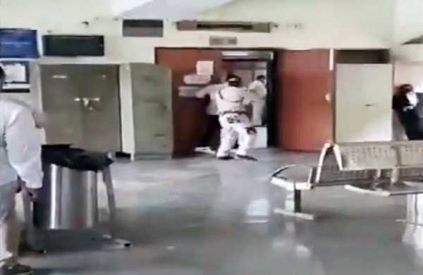 Videograb of a shootout between police and gangsters at the New Delhi court is ongoing on Friday.