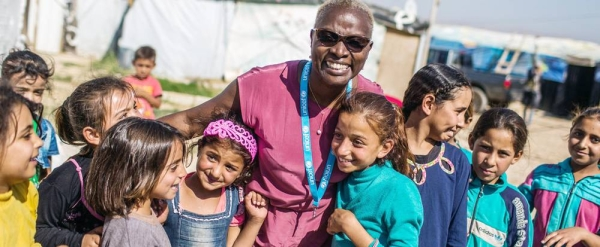 UNICEF Goodwill Ambassador Angelique Kidjo engages with children in the Housh el Refka informal settlement, in Lebanon's Bekaa Valley. — courtesy UNICEF/Diego Ibarra Sanchez