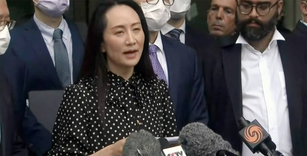 Huawei executive Meng Wanzhou, arrested on a US warrant in 2018, speaks to the press before leaving Canada on Friday in a deal with US prosecutors.